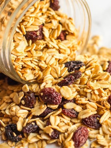 Simple granola pouring out of a mason jar