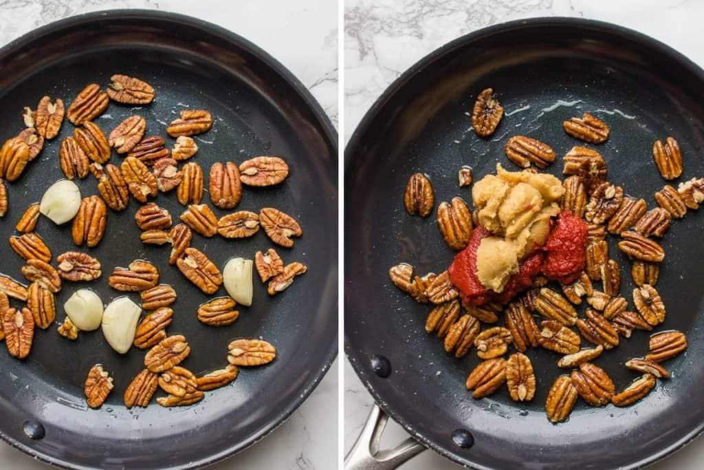 Sautéed walnuts, garlic and tomato paste in a medium dark skillet over white background