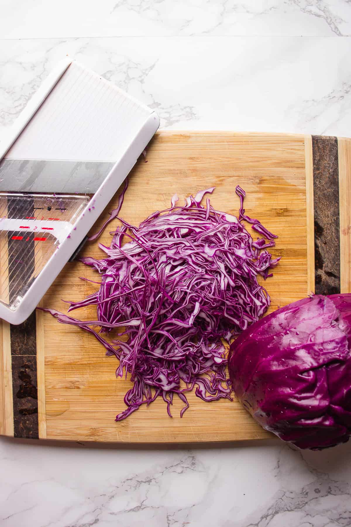 Slicing red cabbage for a slaw