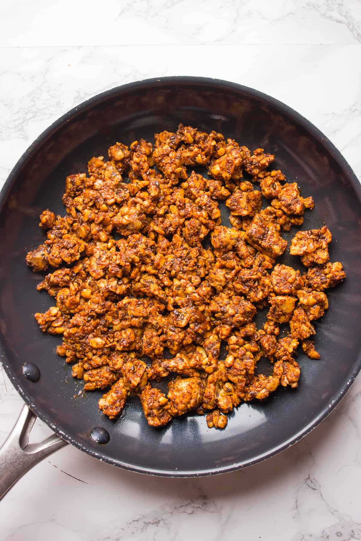 Cooking vegan taco meat in a skillet