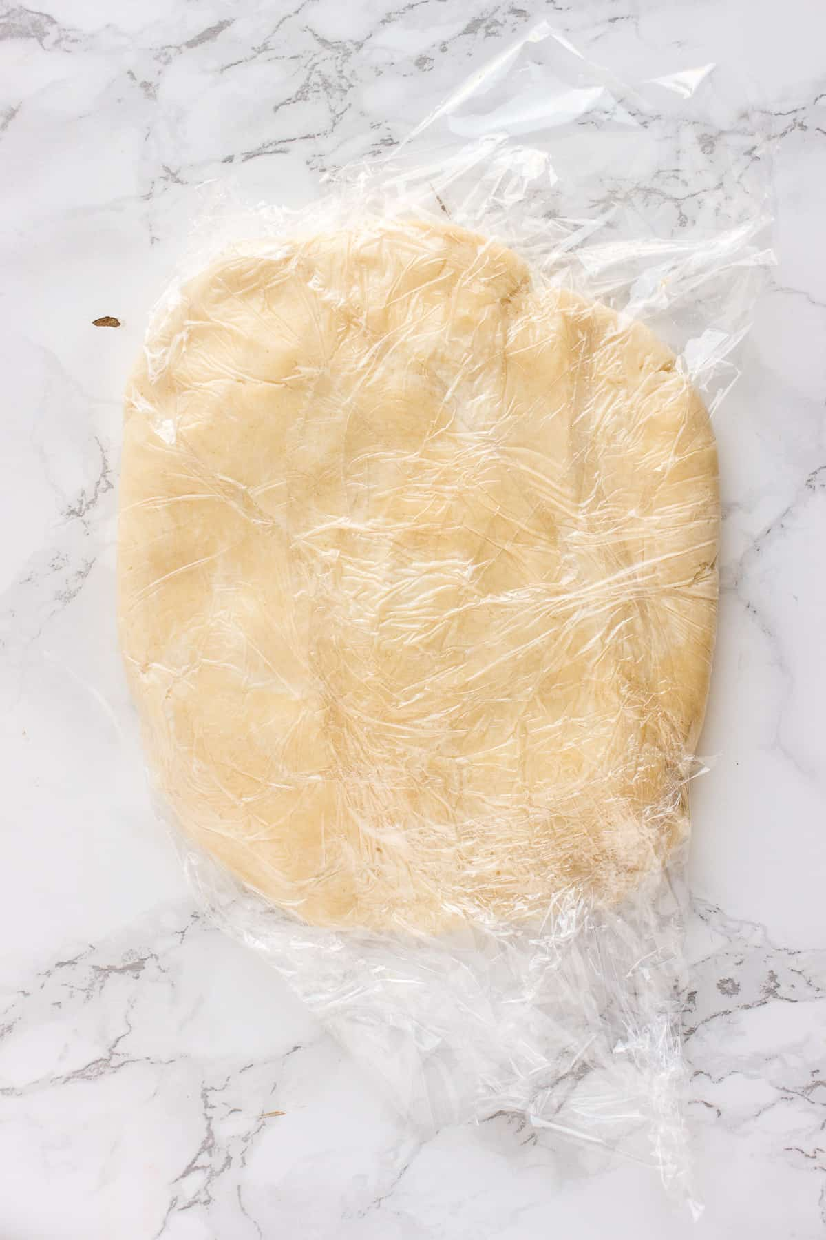 Shortcrust pastry wrapped in plastic wrap