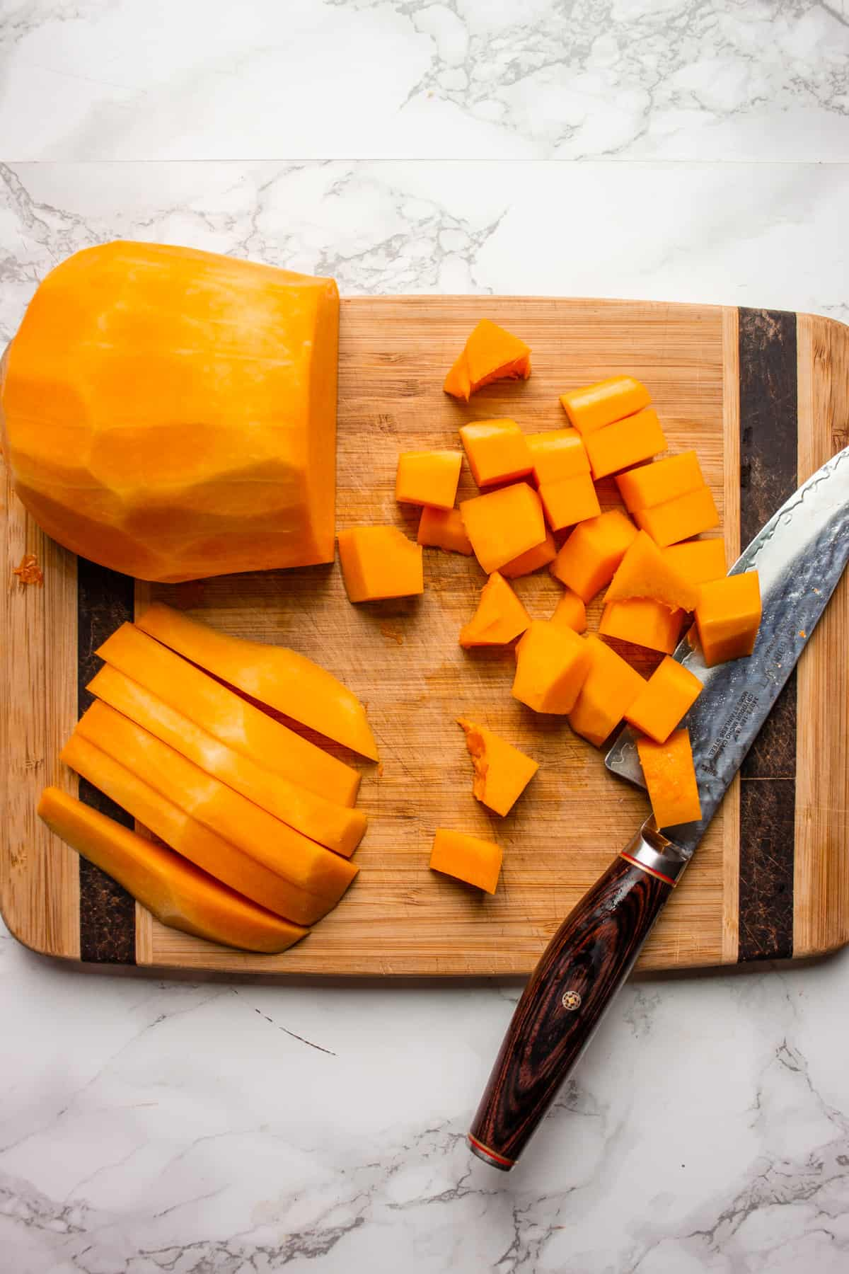 Chopping butternut squash on a chopping board