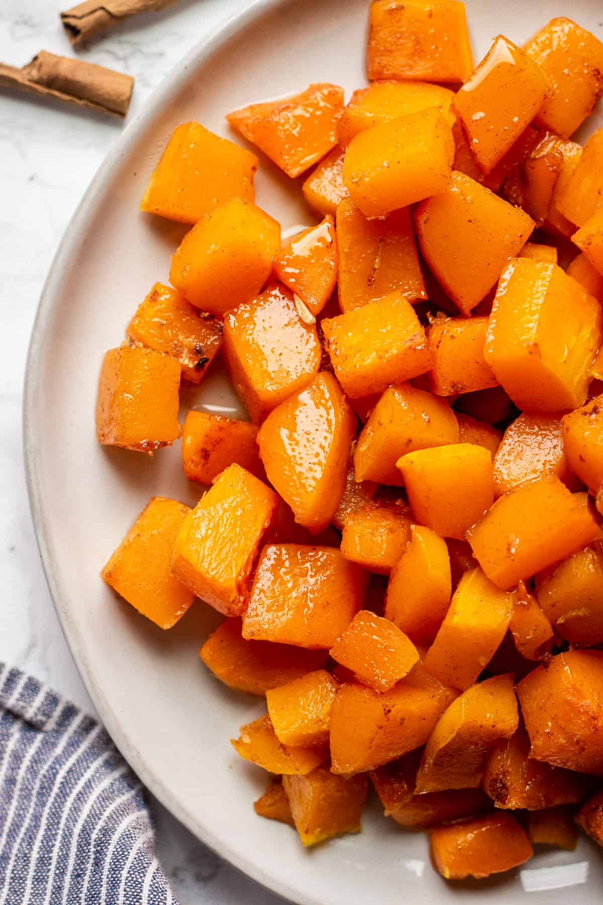 Candied Butternut Squash on a white plate against white background