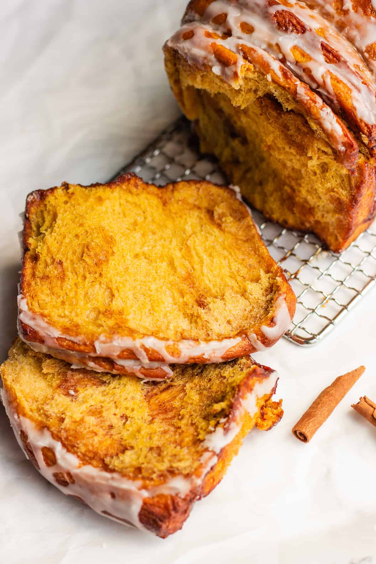 Pull Apart Pumpkin Bread on a wire rack on a white background